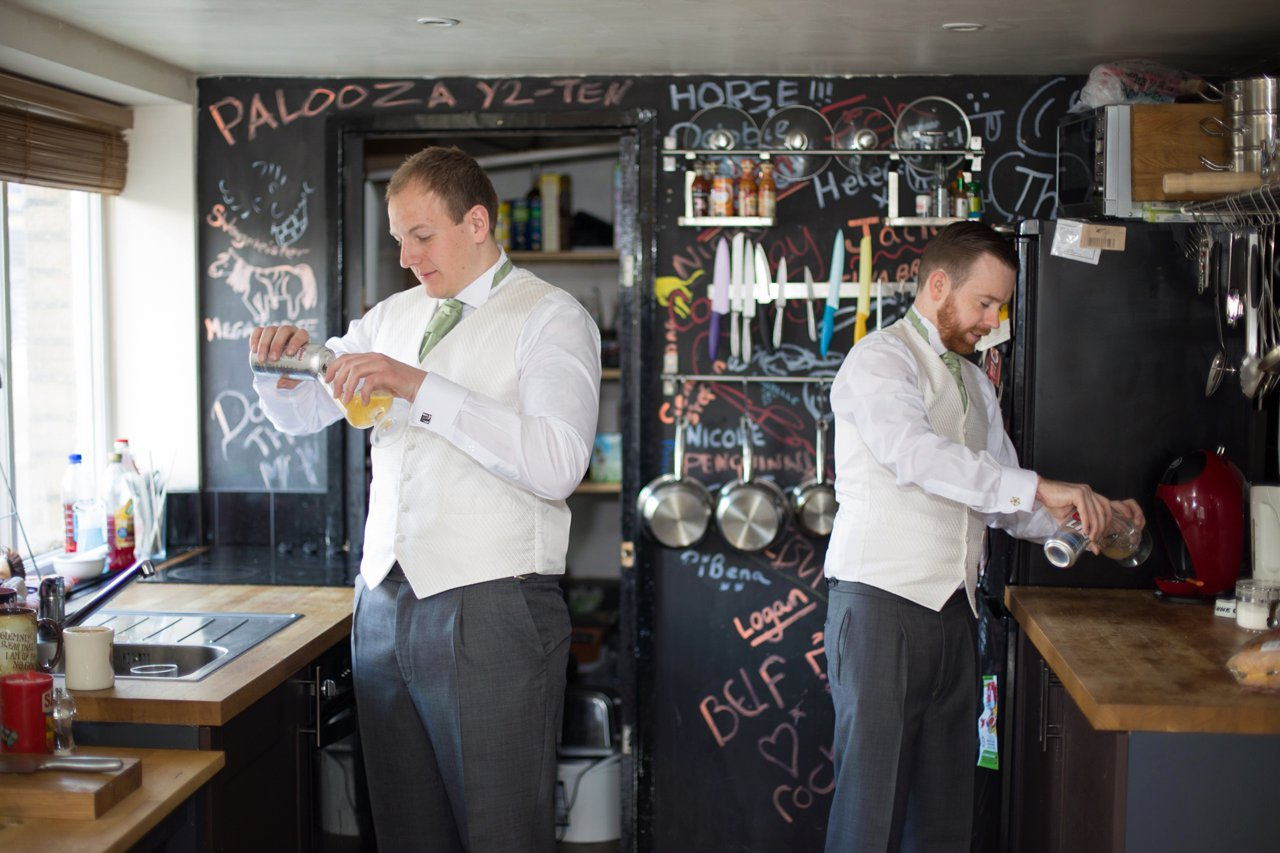 groom and best man having a beer before wedding