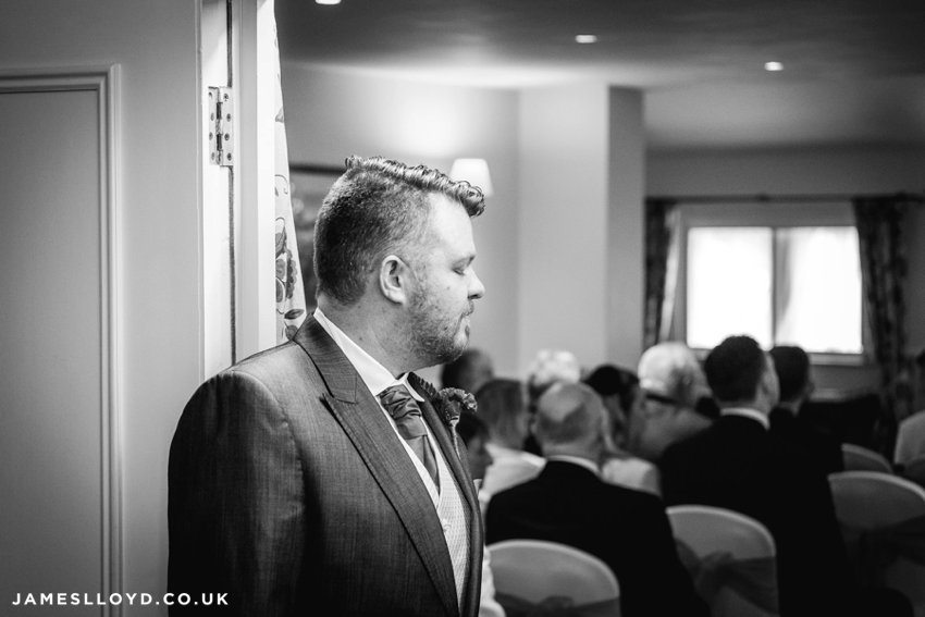 nervous groom awaits bride at Holdsworth House Hotel