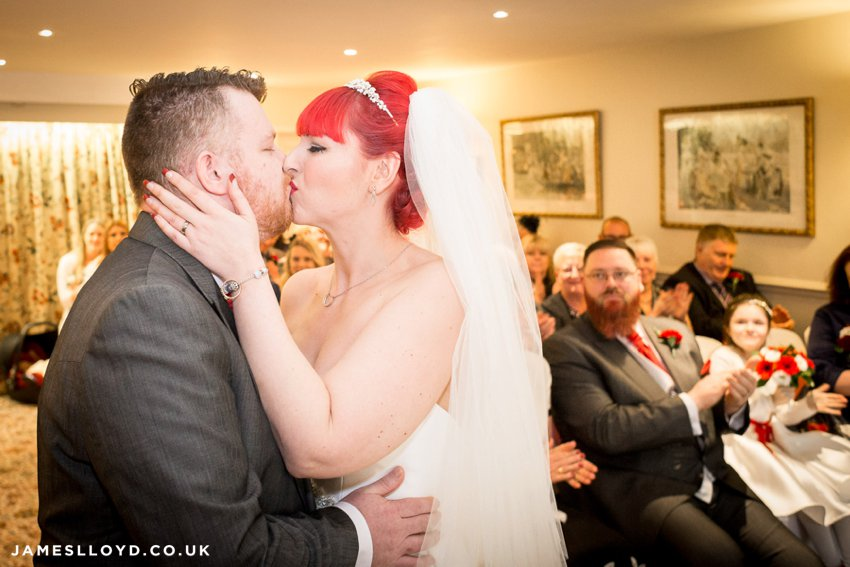 wedding kiss red haired bride at Holdsworth House Hotel
