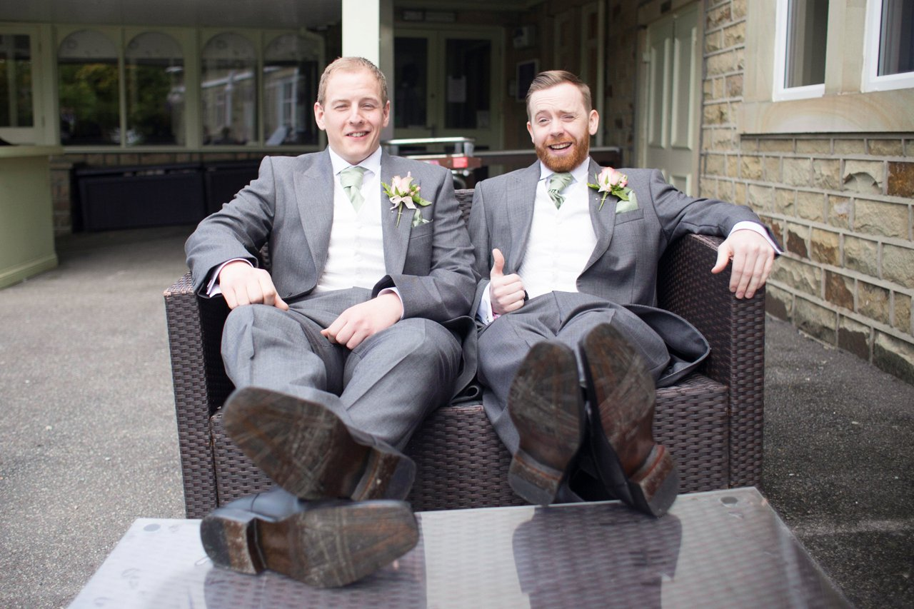 groom and best man with feet on table relaxing at Towerhouse hotel