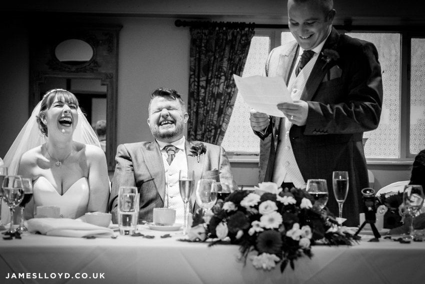 wedding speeches laughing bride and groom