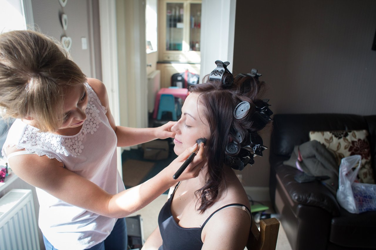 Bride having make up appliied