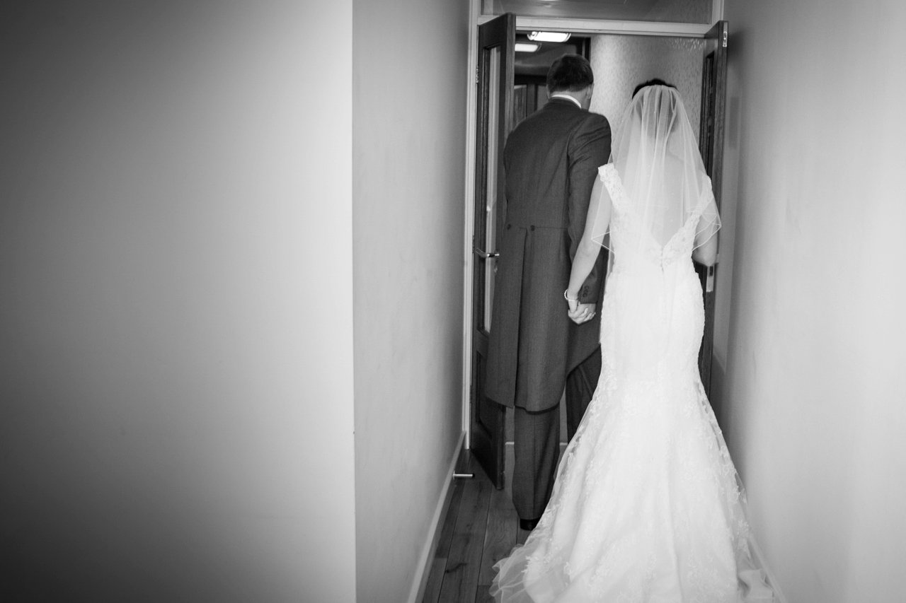 bride and groom leaving through doorway