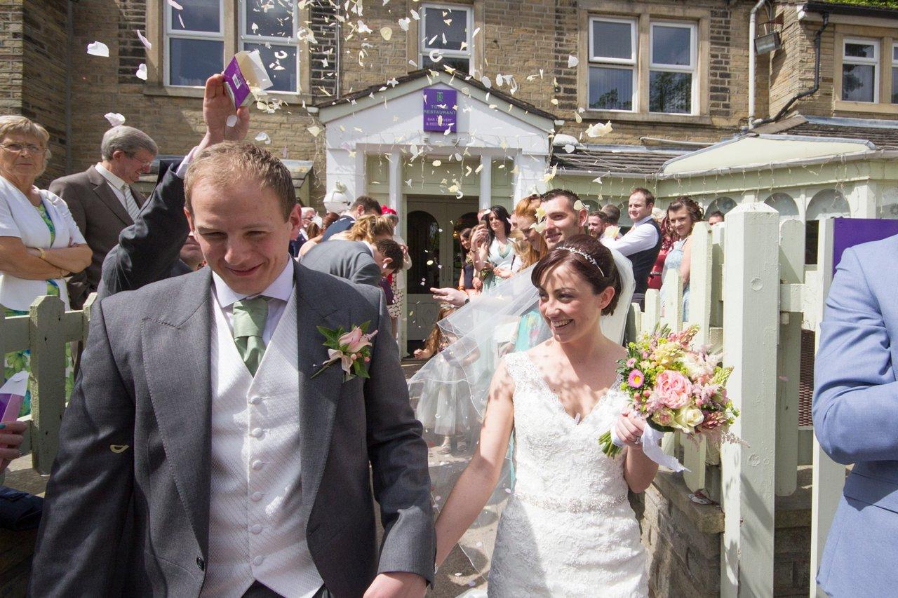 bride and groom confetti in sunlight