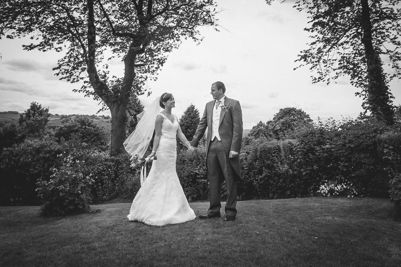 bride and groom formal photo in garden black and white