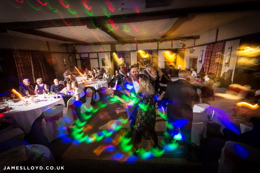 Dancing wedding guests disco lights