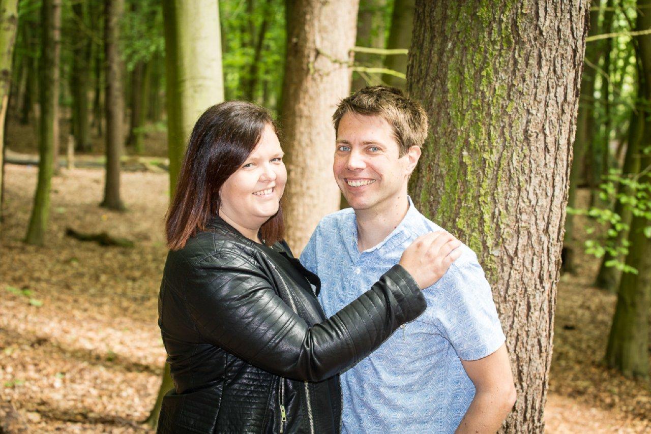 the parents in woodland portrait