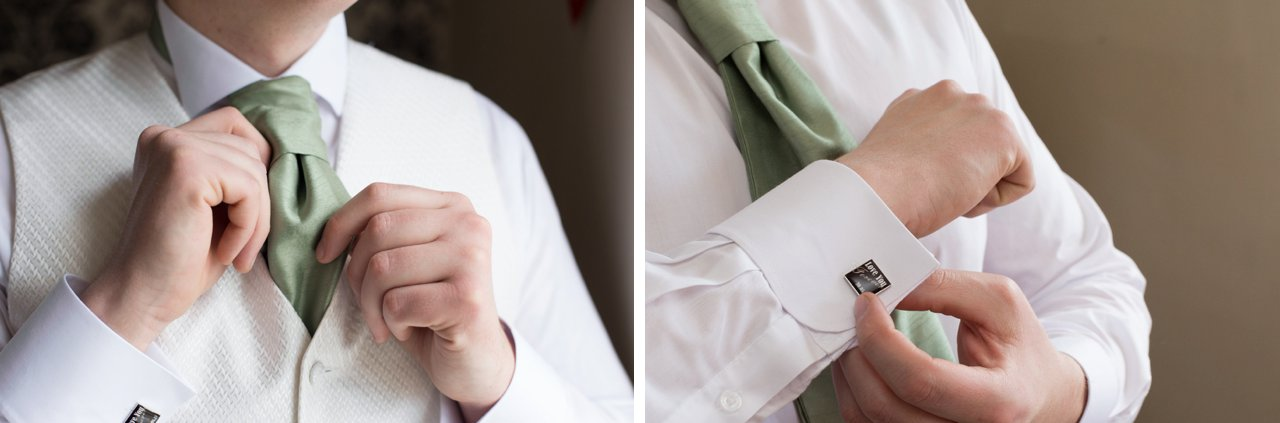 groom tying green cravat and fixing cufflinks