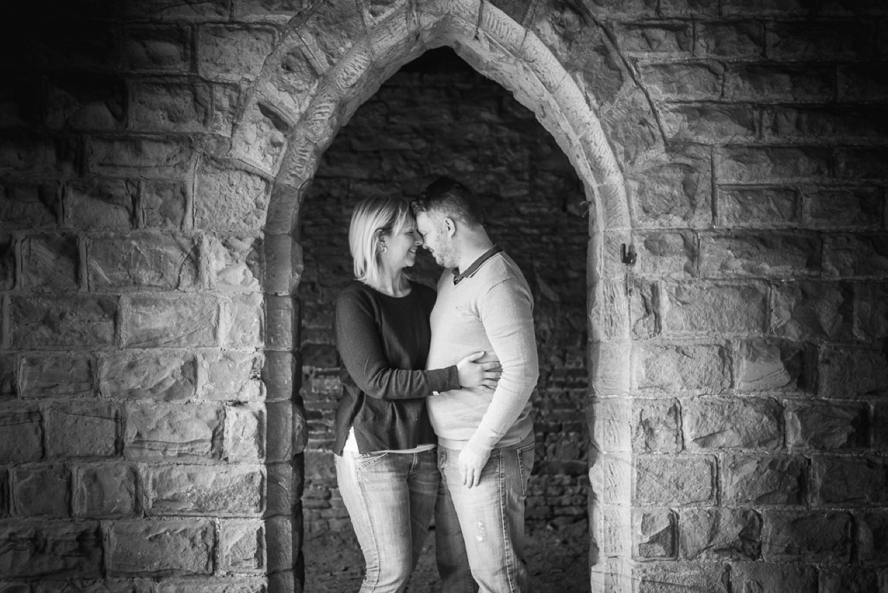 Couple in archway black and white at Deershelter at Cannon Hall