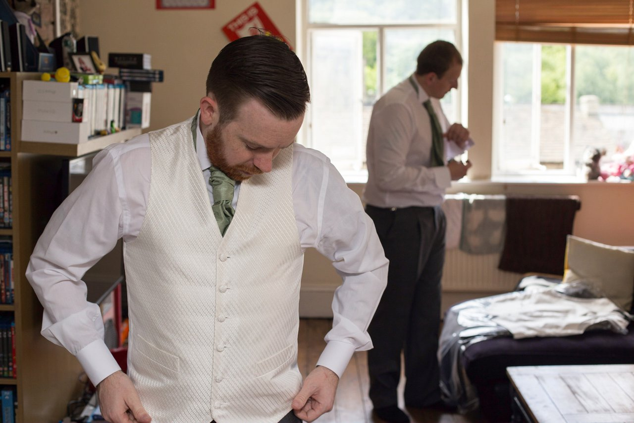 groom and best man getting ready candid