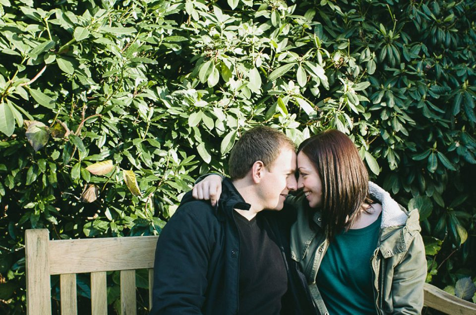 couple looking at each other on park bench