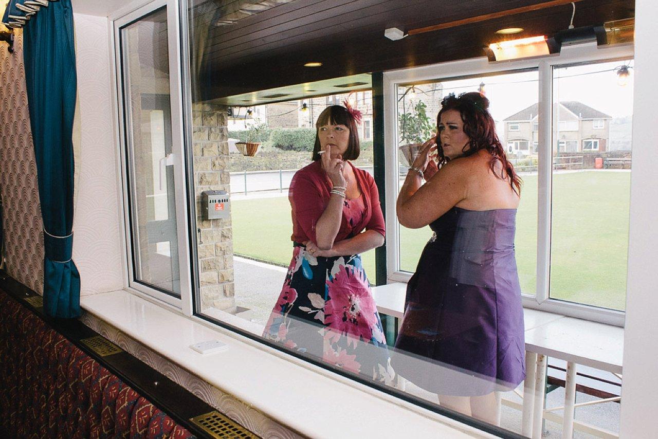 wedding guests sneaky ciggy break