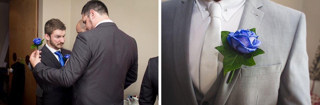 groom gets ready buttonhole