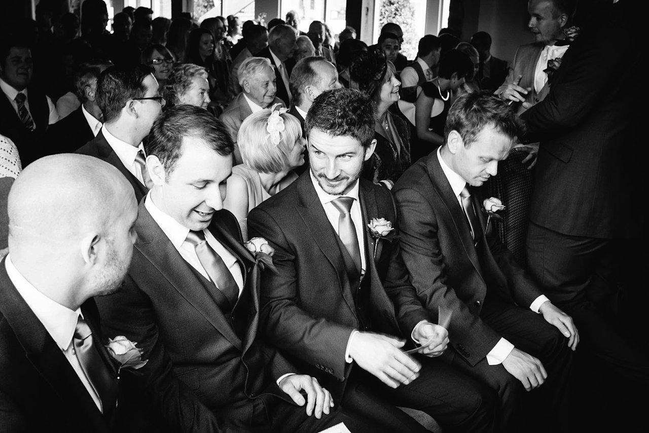 groomsmen laugh and joke