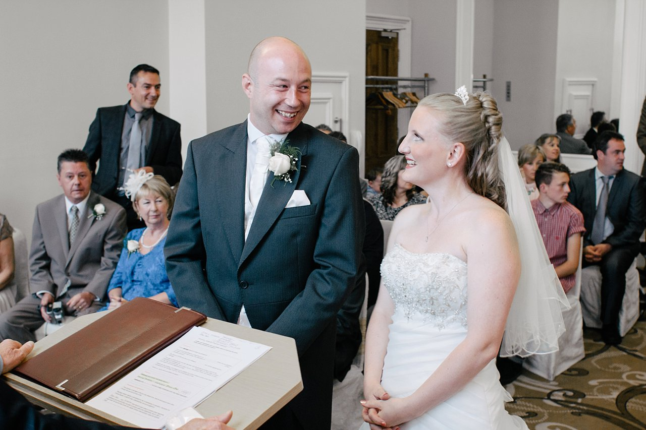 bride and groom at ceremony smiling at Huddersfield town hall