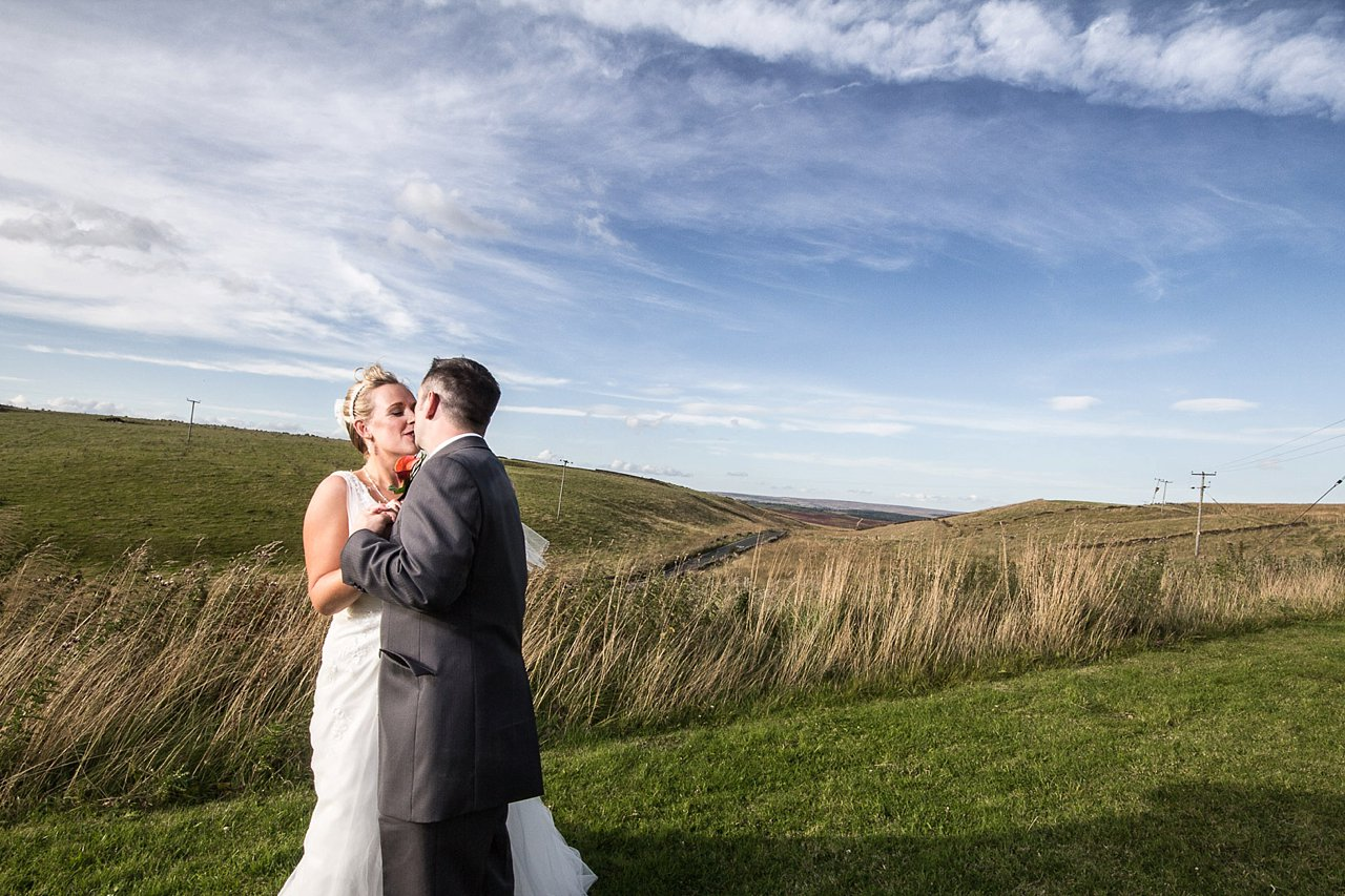 Bride and groom on moorland