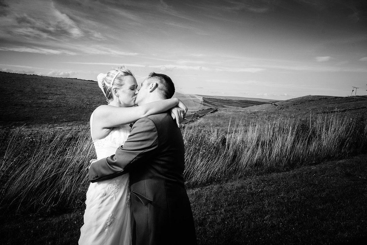 Bride and groom on moorland