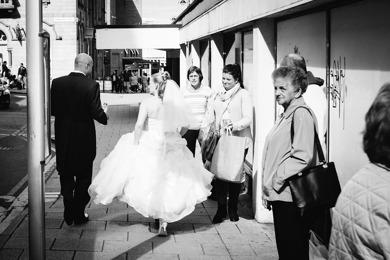 bride and groom and shoppers in Huddersfield