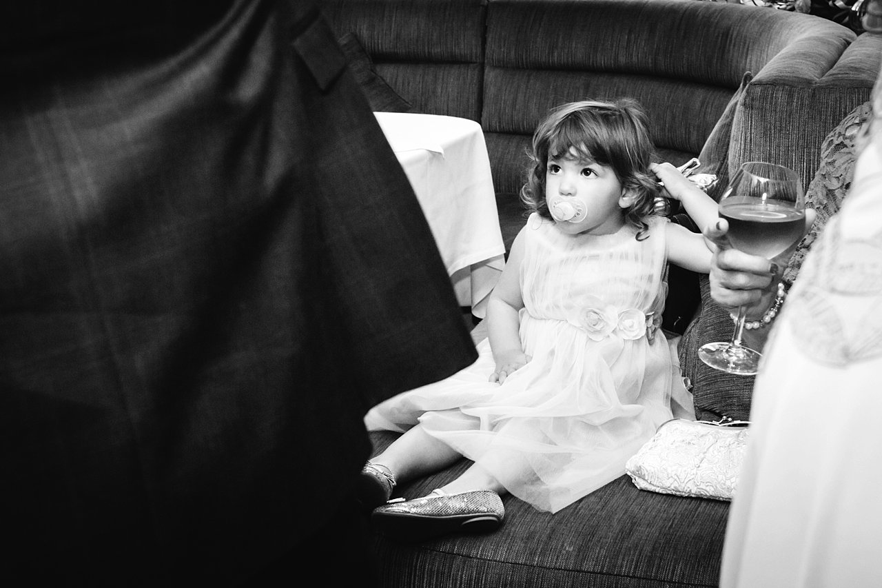 Little girl with pacifier at wedding