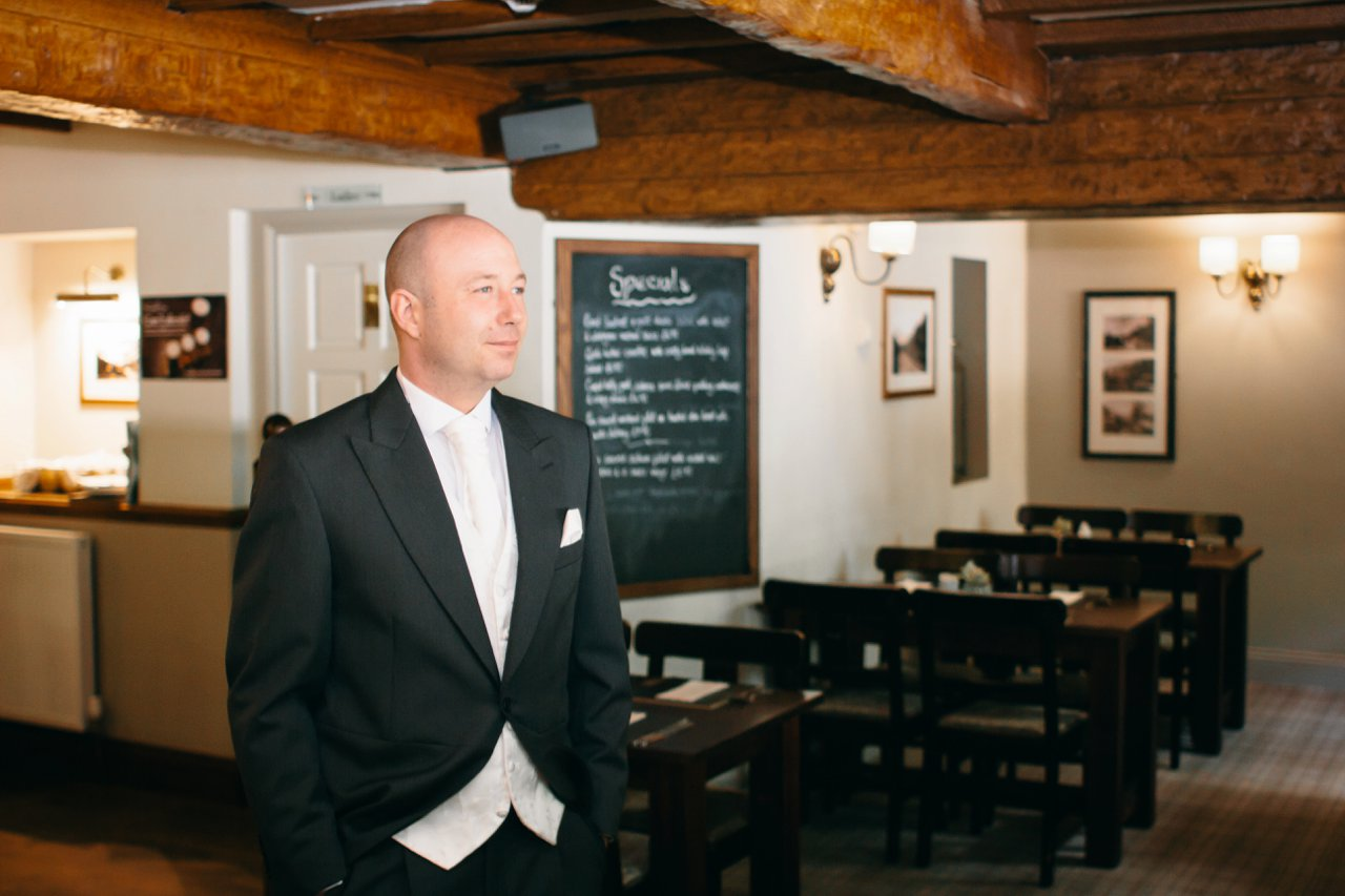 thoughtful groom in pub before wedding
