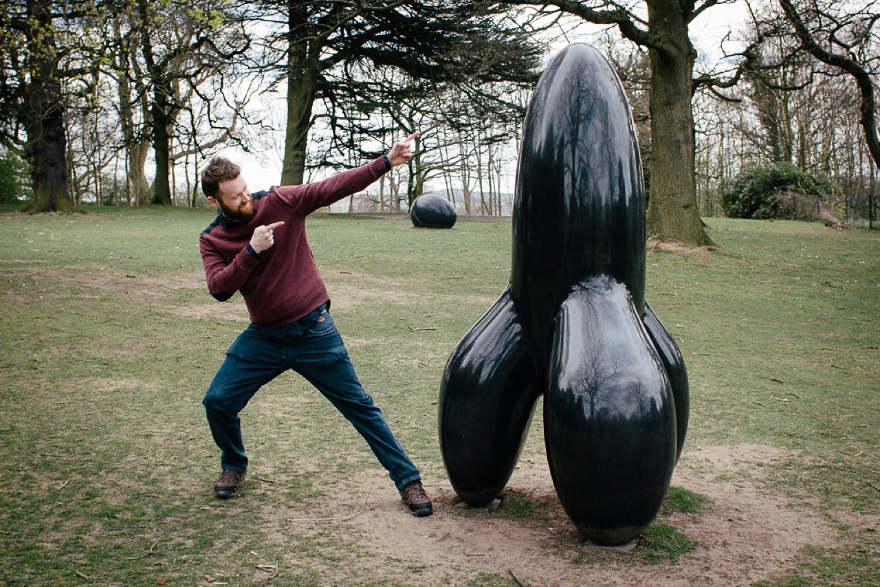 Adam against rocket sculpture