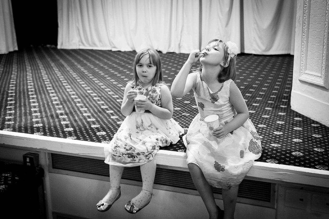 Girls playing on stage at wedding