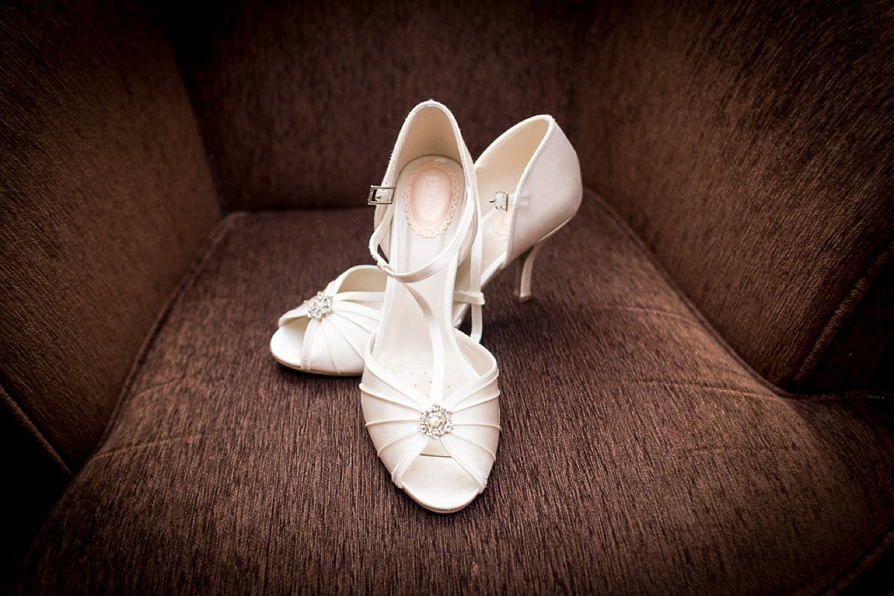 Wedding shoes on brown fabric