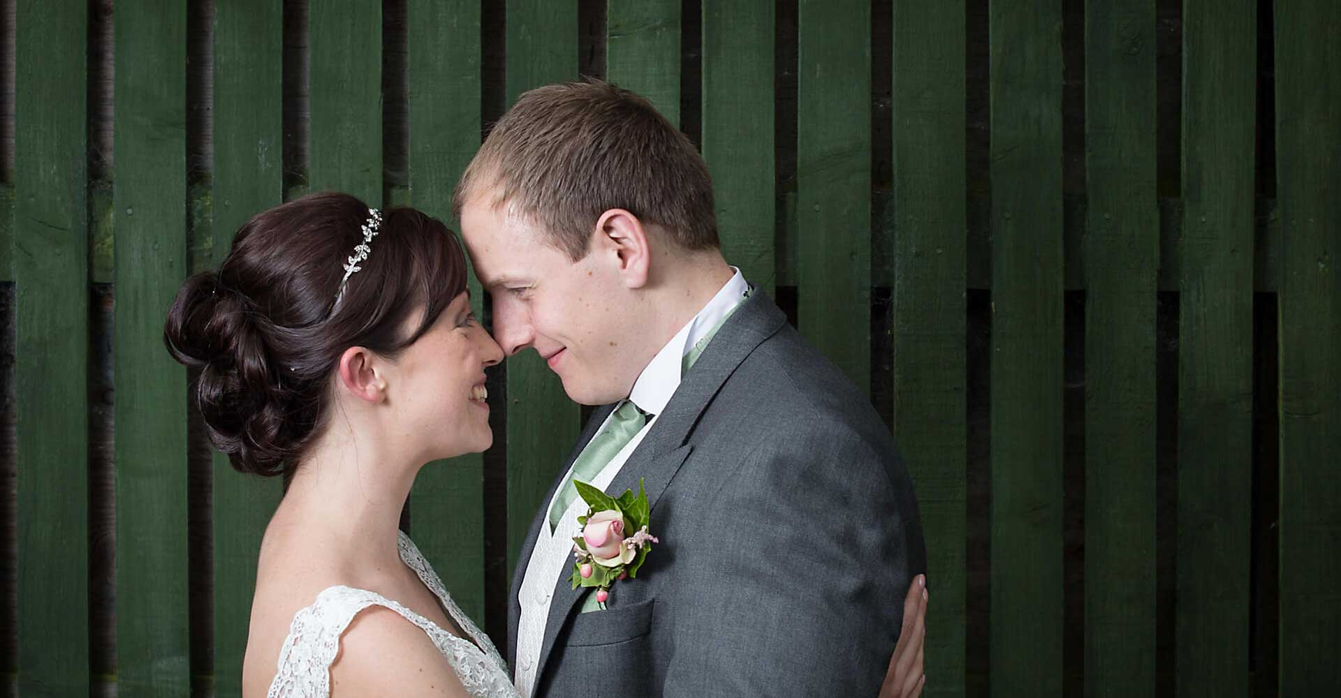 Bride and groom green background