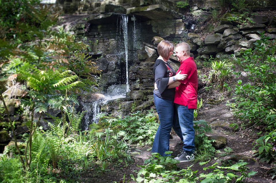 Couple kissing in front of waterfall, Shibden Hall Halifax