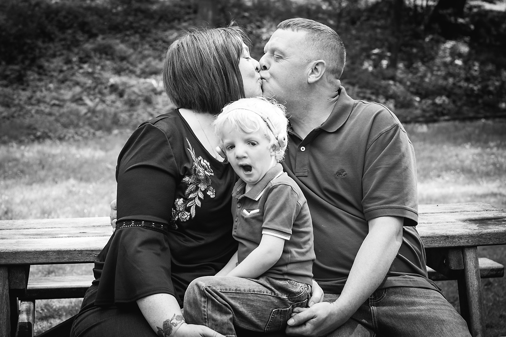 Couple and yawning child family photo