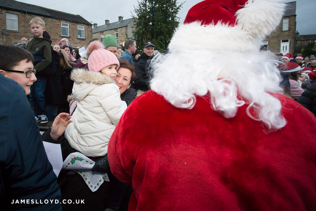 Child excited to see father christmas