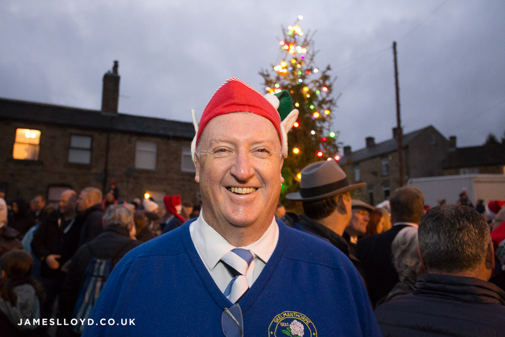 Happy man in front of skelmanthorpe christmas tree